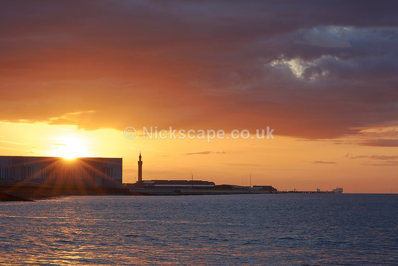 Photo of Grismby Docks and Tower from Cleethorpes at sunset | Photography by Nickscape