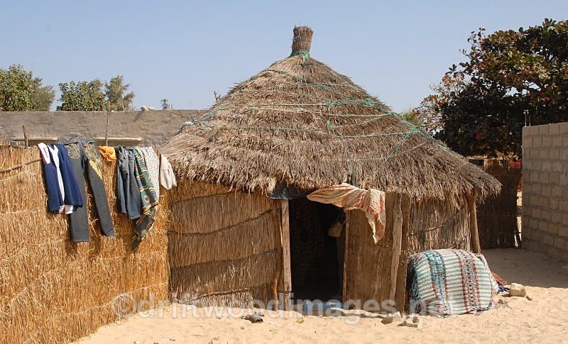 Senegal Fulani Senegal village hut exterior with washing - Senegal Fulani Village