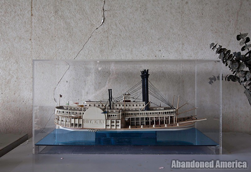 Steamboat model in abandoned office - Matthew Christopher's Abandoned America